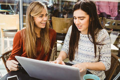 Friends using laptop together Stock Photography