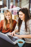 Friends using laptop together Royalty Free Stock Images