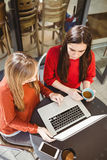 Friends using laptop together Royalty Free Stock Image