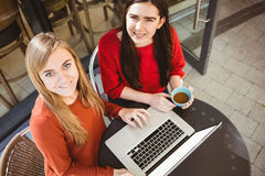 Friends using laptop together Stock Images