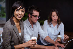 Friends using laptop together. In a cafe Royalty Free Stock Photo