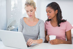 Friends using laptop together Royalty Free Stock Photo