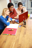 Friends using laptop together Royalty Free Stock Photos