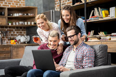 Friends using laptop Royalty Free Stock Images