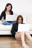 Friends using laptops Royalty Free Stock Photos