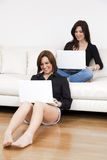 Friends using laptops Stock Photo