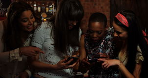 Friends using smartphone at bar counter. In pub stock footage