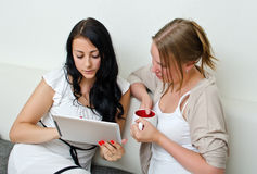 Friends using a tablet PC. Two women friends using a tablet PC computer Stock Images