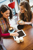 Friends using tablet together Royalty Free Stock Image
