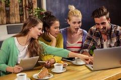 Friends using technology Stock Photos