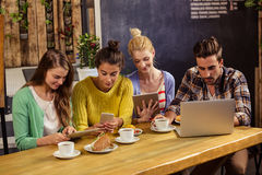 Friends using technology Royalty Free Stock Photography