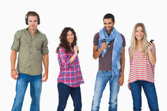 Friends using various types of technology Stock Images