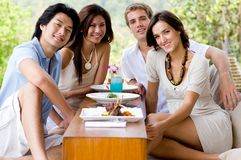 Friends On Vacation. A group of young adults having lunch on vacation royalty free stock images