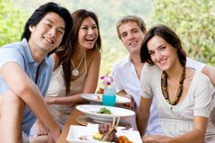 Friends On Vacation. A group of young adults having lunch on vacation Stock Photos