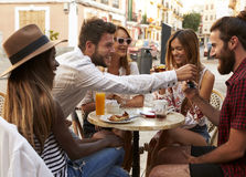 Friends on vacation having fun outside a cafe in Ibiza Royalty Free Stock Photo