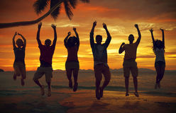 Friends Vacation Sea Summer Jumping Shot Concept Stock Photo