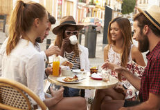 Friends on vacation at a table outside a cafe in Ibiza Royalty Free Stock Photos