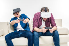 Friends in virtual reality headsets Stock Image