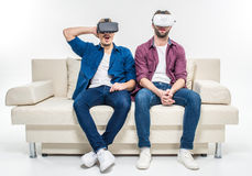 Friends in virtual reality headsets stock images