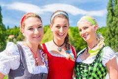 Friends visiting Bavarian fair having fun stock images
