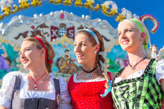 Friends visiting Bavarian fair having fun Royalty Free Stock Images