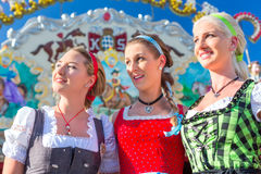Friends visiting Bavarian fair having fun Royalty Free Stock Photos