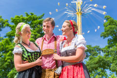 Friends visiting Bavarian folk festival Stock Image