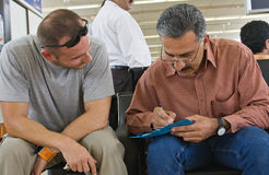 Friends waiting in airport Stock Photography