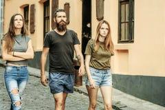 Friends walk on city street, vacation royalty free stock photos