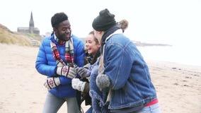Friends Walking Along A Winter Beach stock video
