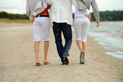 Friends walking on the beach Royalty Free Stock Photography