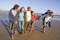 Friends walking on beach together Royalty Free Stock Photography