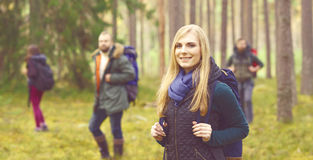 Friends walking in forest and enjoying a good autumn day. Camp, Royalty Free Stock Image