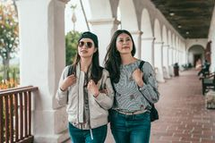 Friends walking in hallway and looking around. royalty free stock image