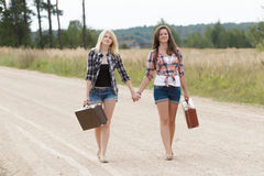 Friends walking and holding hands Royalty Free Stock Images