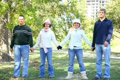 Friends Walking In Park Royalty Free Stock Image