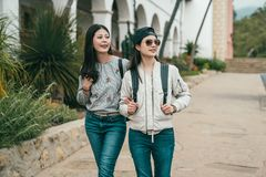 Friends walking in sidewalk and feeling cheerful stock images