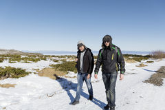 Friends walking in the winter mountain.winter holiday Stock Photo