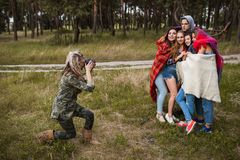 Friends warm together photoshoot nature concept. Stock Images