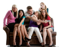 Friends watch TV. Royalty Free Stock Photography