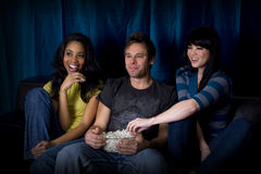 Friends watch TV Royalty Free Stock Photography