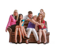 Friends watch TV. Royalty Free Stock Photo