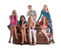 Friends watch TV. Stock Photos