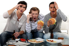 Friends watching a football game Stock Photography
