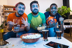 Friends watching football game Royalty Free Stock Photography