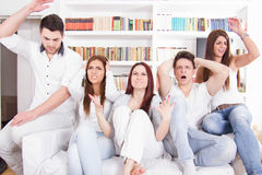 Friends watching football game and their team is losing Royalty Free Stock Image