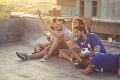 Friends watching football royalty free stock images