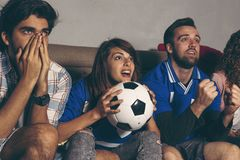 Friends watching football stock photos