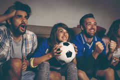 Friends watching football stock images
