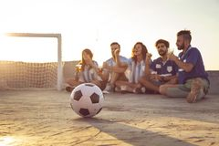Friends watching a football match royalty free stock image